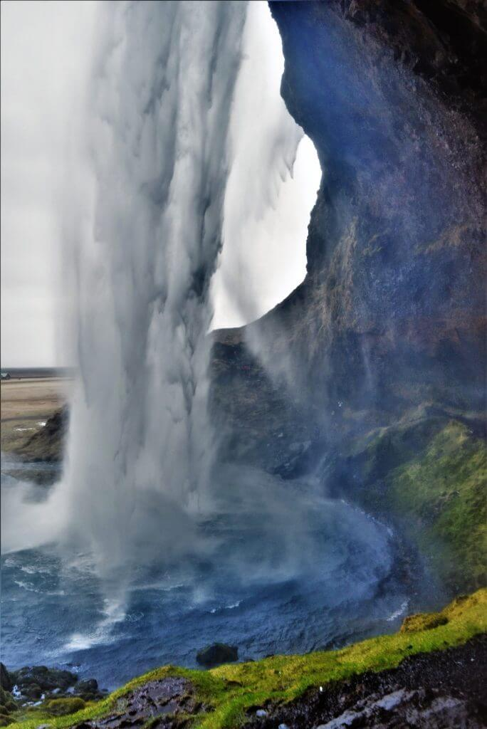 Behind the water curtain at Seljalandsfoss Waterfall, Iceland