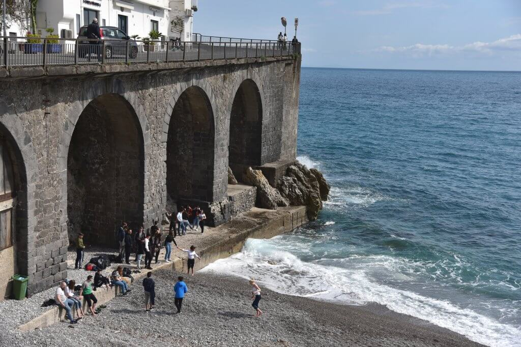 Frollicking under the aqueduct at Amalfi beach