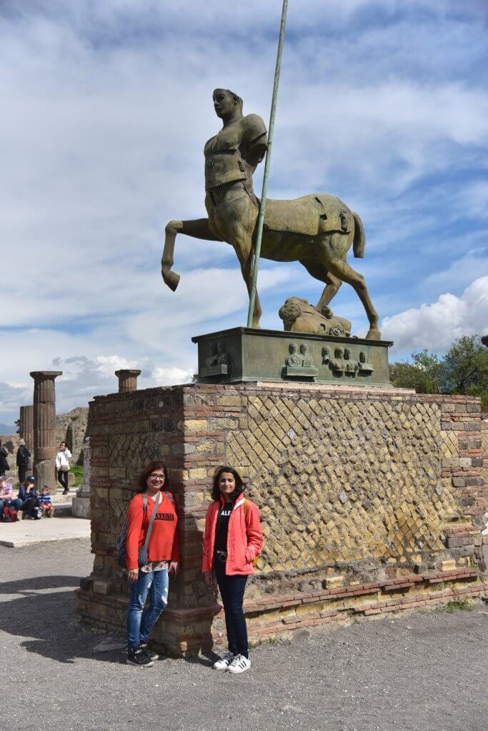 In front of the statue of the Centaur in Pompeii