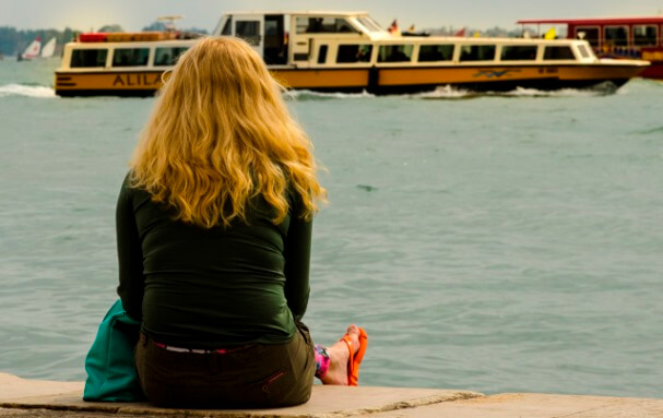 Girl watching boats